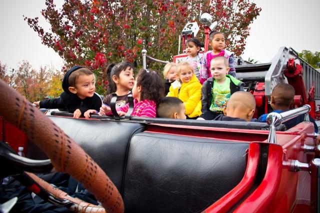 Children on a classic firetruck