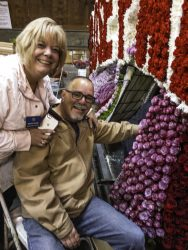 Placing roses - Rose Parade float